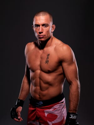 This is UFC fighter Georges St-Pierre. (Photo: Josh Hedges, Zuffa)