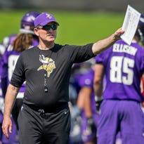 Minnesota Vikings head coach Mike Zimmer speaks to his team at practice Wednesday at Winter Park in Eden Prairie.