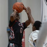 Alterique Gilbert takes a shot during the Nike Elite Youth Basketball League at Kentucky Basketball Academy in Lexington,Ky., on Saturday April 25, 2015.