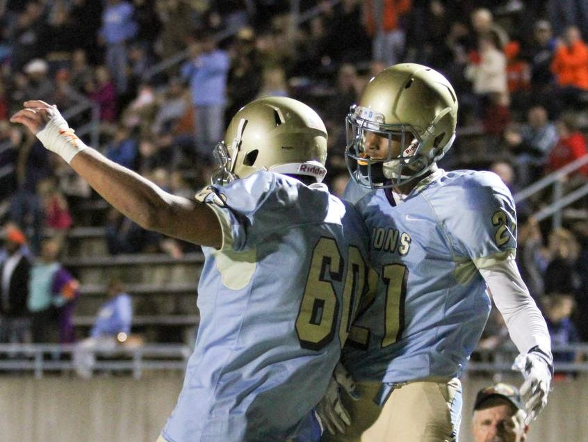 Daniel reciever CJ Scott (21) celebrates with teammate Dylan Perry (60) after scoring a touchdown against Seneca Friday night.