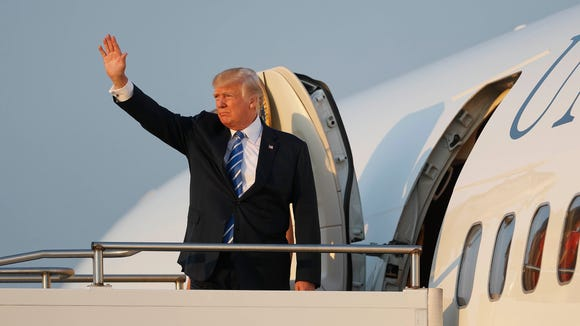 President Donald Trump waves while boarding Air Force