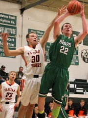 Luke King puts up a shot while being guarded by Capitan's Oliver Schultz.