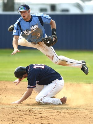 Watkins' Kevin Kramer leaps out of the way of New Market's Bryce Rippentrop as he slides into second base in the third inning during a  previous state amateur baseball tournament in Watkins.