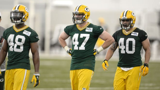 Green Bay Packers rookie Jake Ryan (47) pauses between drills with Joe Thomas (48) and Uona Kaveinga (40) during rookie orientation May 8 in the Don Hutson Center.