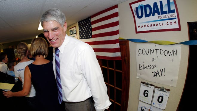 Sen. Mark Udall, D-Colo., greets supporters during appearance at a campaign headquarters in northwest Denver suburb of Wheat Ridge, Colo., on Sept. 5, 2014.