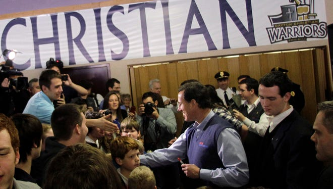 Republican presidential candidate, former Pennsylvania Sen. Rick Santorum visits with students at the Dayton Christian School, Monday, March 5, 2012, in Miamisburg, Ohio. Santorum won the Iowa Republican primary that year.