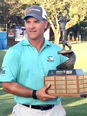 Scott McCarron holds the trophy after winning the Allianz Championship Sunday at Broken Sound in Boca Raton, Florida, thanks to an eagle on the final hole to beat Kenny Perry and Carlos Franco by one shot. It was McCarron's third PGA Tour Champions win.