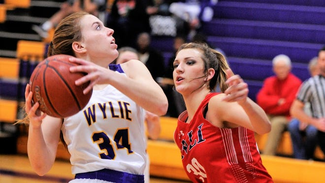 Wylie's Julia Lovelace drives goes into the lane against Jim Ned's Torey Bradshaw during Tuesday night's game.