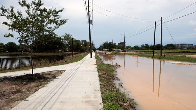Rains on Thursday, June 15, 2017, flooded Government Street south of the new regional stormwater pond at Corrine Jones Park in downtown Pensacola. City officials say the flooding should be alleviated once construction is complete.