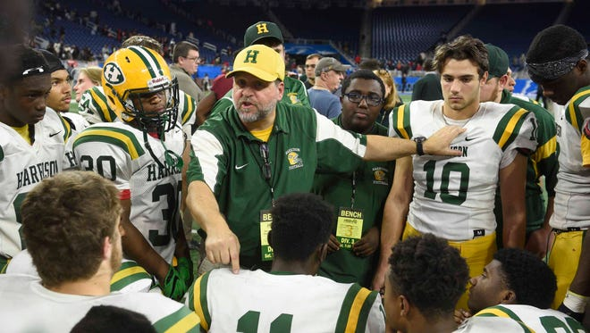 Farmington Harrison's longtime defensive coordinator Dave Thorne (center) is headed to the Michigan High School Football Coaches Association Hall of Fame.