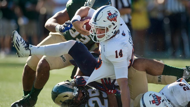 CSU defenders Kevin Davis (33) and Justin Sweet (29) tackle Texas-San Antonio quarterback Dalton Sturm during a Sept. 10 game at Hughes Stadium. CSU's run defense will be tested during the final three weeks of the regular season, when the Rams face three of the top 15 rushing offenses in the country.