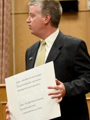 Assistant Licking County prosecutor Cliff Murphy displays transcripts from an interview between Thomas Kosto and police in court on Tuesday, June 27, 2017. KostoÊis charged with involuntary manslaughter, corrupting another with drugs, tampering with evidence and possession of heroin in relation to Chad Baker's overdose death on May 29, 2015.Ê