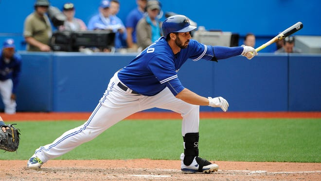 Blue Jays left fielder Chris Colabello hits a two-run RBI single in the ninth inning at Rogers Centre.