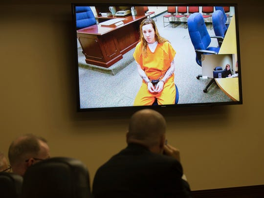 Bailey Boswell appears via video conference during her first court appearance before Saline County Judge Linda Bauer at the Saline County Courthouse Tuesday, June 12, 2018 in Wilber, Neb. A Nebraska woman who went missing in November was still alive when Boswell and Aubrey Trail, accused of killing her, were caught on store surveillance video buying the tools that police think they used to dismember her, prosecutors allege in newly unsealed court documents. (Rebecca S. Gratz/Omaha World-Herald via AP)