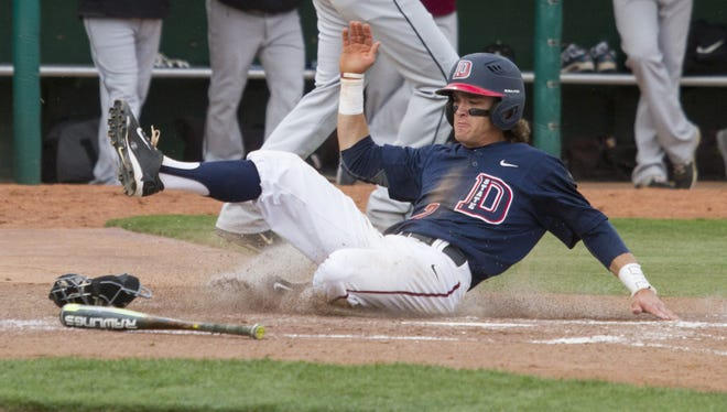 Dixie State second baseman Drew McLaughlin slides into home against Azusa Pacific Thursday, April 14, 2016.