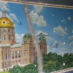 Timelapse: Mural uncovered in historic Des Moines building