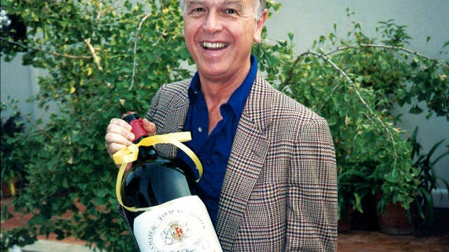 This circa 1985 photo provided by Esme Gibson shows Joe Coulombe, the founder of the Trader Joe's market chain, at his home in Pasadena, Calif. Coulombe, the man who created Trader Joe's markets with a vision that college-educated but poorly paid young people would buy healthy foods if they could only afford them, has died. Coulombe's family says he died Friday at age 89. He opened the first of his quirky, nautically themed markets in Pasadena, California, in 1967. He stocked it with granola, organic foods and other items he bought directly from suppliers to hold prices down. Trader Joe's now has more than 500 stores in over 40 states.