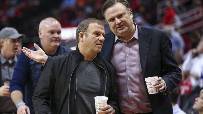 Houston Rockets owner Tilman Fertitta (left) and general manager Daryl Morey (right) talk during the game against the Memphis Grizzlies at Toyota Center.