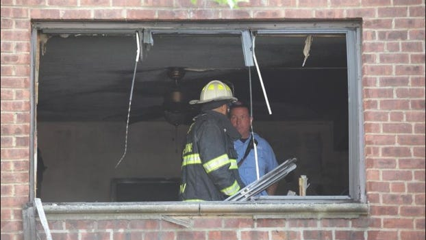 Firefighters work in the superintendent's apartment where a fire broke out in the Linden View Apartments at 631 N. Terrace Ave. in Mount Vernon on July 29, 2014