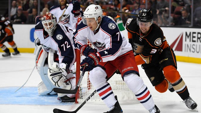 Columbus Blue Jackets defenseman Jack Johnson, center, skates with the puck against the Anaheim Ducks on Oct. 28, 2016, in Anaheim, Calif.