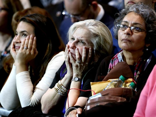 Three women watch the results at Hillary Clinton's
