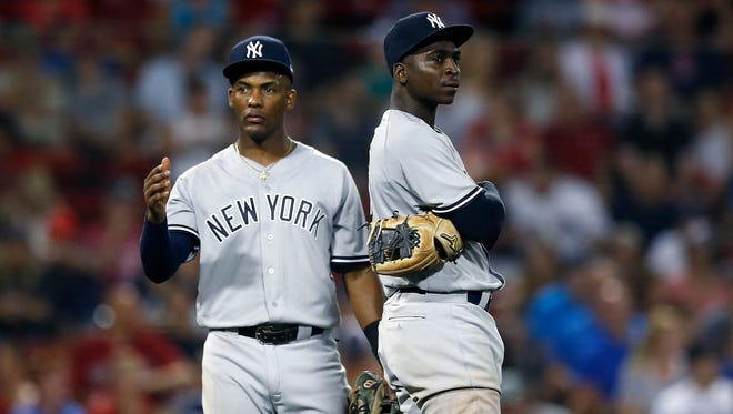 New York Yankees' Miguel Andujar, left, Didi Gregorius stand on the field during a pitching change in the eighth inning of the team's baseball game against the Boston Red Sox in Boston, Thursday, Aug. 2, 2018.