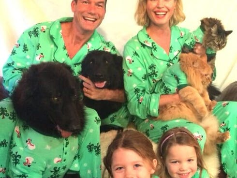 Actress Rebecca Romijn posted a photo on Twitter of her family getting ready for the holidays.