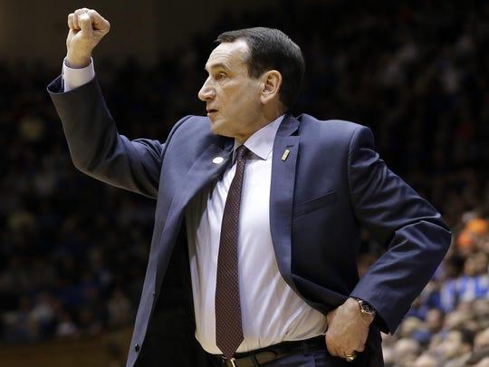 Duke head coach Mike Krzyzewski gestures during the second half of an NCAA college basketball game against Virginia in Durham Saturday, Feb. 13. Duke won 63-62.