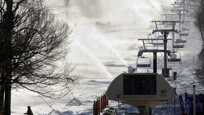 Snowmaking is seen in a file photo at Wachusett Mountain Ski Area. [T&G File Photo/Paul Kapteyn]        12-19-11 CUTLINE:  GIVING WINTER A LIFT: Snowmaking is being done in earnest yesterday at Wachusett Mountain Ski Area in Princeton as the new quad lift, the Monadnock Express, was officially opened.