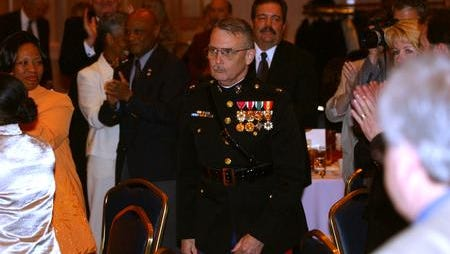 In this file photo, Lt. Col. Ronald Harrington of Snow Hill High School walks among the crowd of clapping hands to accept the 2004 Worcester Teacher of the Year award during the WeXL Teachers banquet at the Clarion Resort Fontainebleau in Ocean City on Friday, April 2.