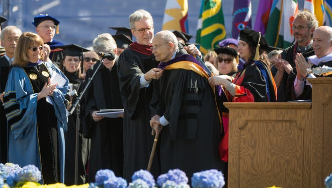 Former U.S. Rep. John Dingell receives an honorary degree at the University of Michigan's spring commencement ceremony on May 2, 2015 at Michigan Stadium.