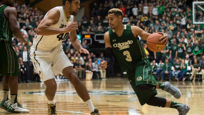 Gian Clavell, CSU's leading scorer at 21.1 points a game, drives past the University of Colorado's Josh Scott during a game last Sunday at Moby Arena. The Rams face Northern Colorado on Sunday in Greeley.