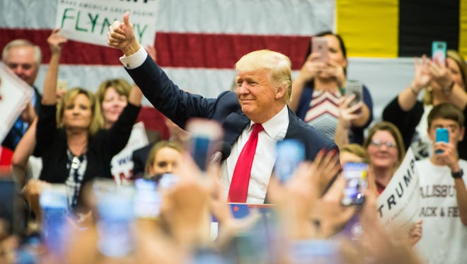Donald Trump flashes a thumbs up during a rally held at Stephen Decatur High School on Wednesday, April 20 in Berlin.