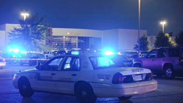 Police surround the Grand Theatre following a shooting on Thursday, July 23, 2015, in Lafayette, La.