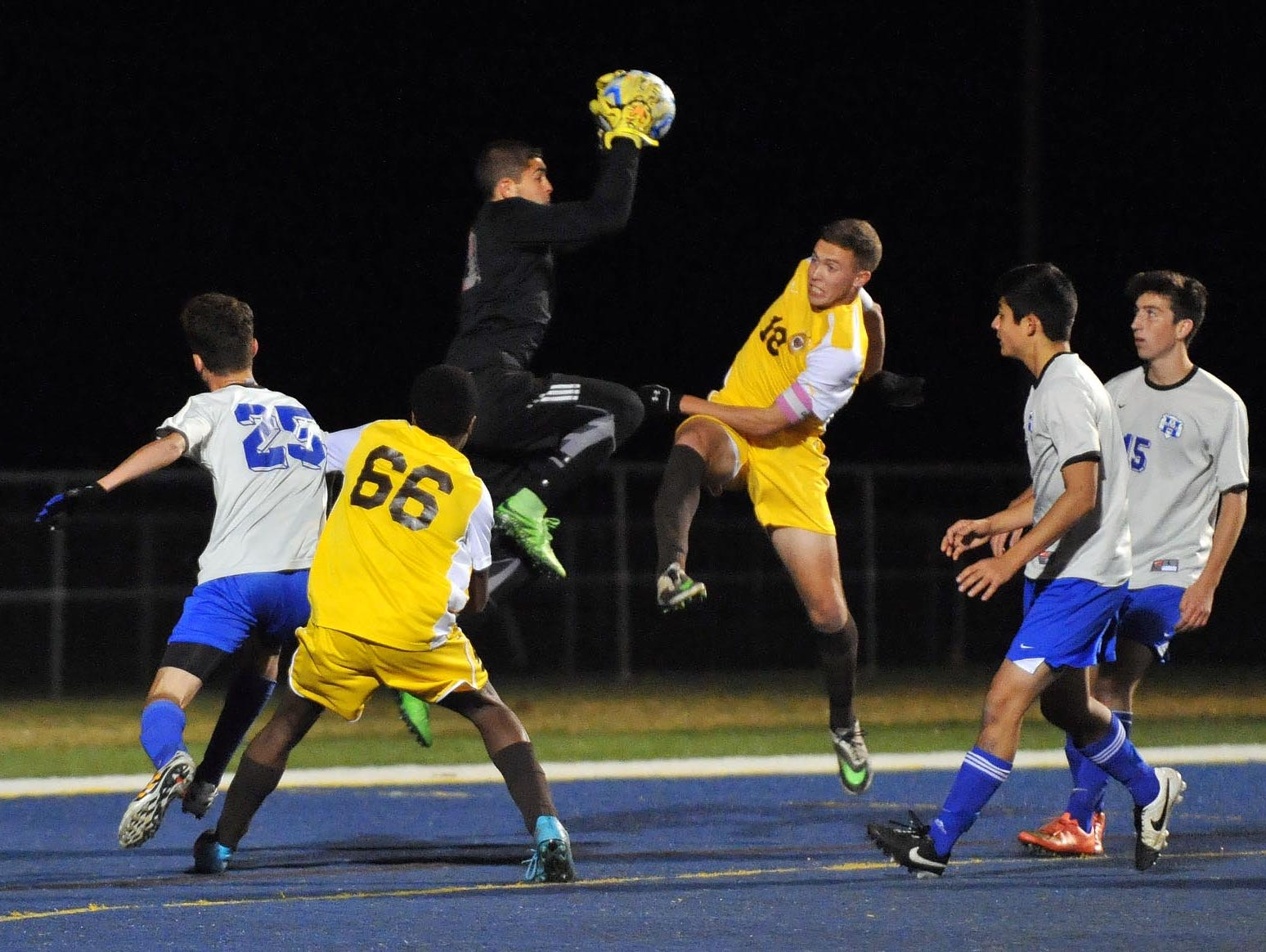 Holmdel goalkeeper Tyler Marchiano (top) makes a save against Delran in their Group 2 boys' soccer semifinal, Tuesday, Nov. 17 in Buena Vista.