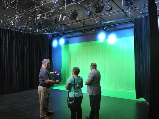 Chad Johnson, audio-visual production instructor, explains the green screen technology he will be teaching using the new studio and control room of the Career Education Center.