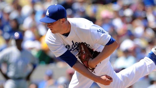 Dodgers starting pitcher Brock Stewart throws during