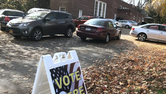 Cars drive in and out of the parking lot at New Day Ministry on Tuesday. The church was among polling places for Tuesday's election.