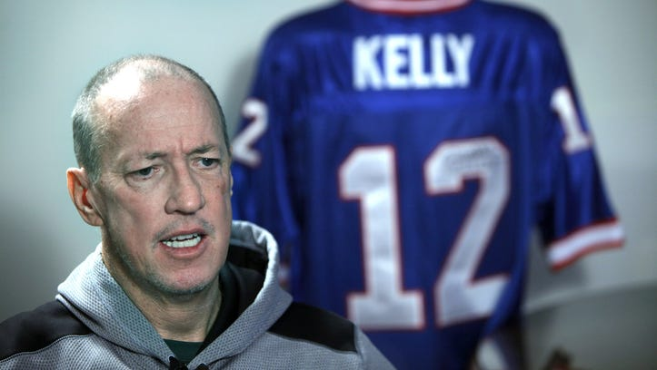 Buffalo Bills legend Jim Kelly, seen here during and interview with Democrat and Chronicle reporter Sal Maiorana, was recently declared cancer-free three months after completing his treatment for sinus cancer in Williamsville, Buffalo, N.Y. on Wednesday, September 10 2014. He also expressed his happiness to know that the Buffalo Bills team will remain in Buffalo.