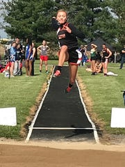 Lucas' Emily Niswander, the 2017 state runner-up, won a Division III district long jump title last Saturday on her final attempt.