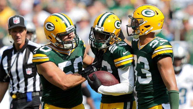 Green Bays' Damarious Randall celebrates a defensive play with Blake Martinez, left, and Micah Hyde, right, during a game in 2016.