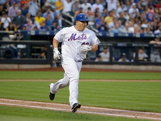 New York Mets starting pitcher Bartolo Colon reacts after hitting a double during the third inning of a baseball game against the Pittsburgh Pirates, Thursday, June 16, 2016, in New York. (AP Photo/Frank Franklin II)
