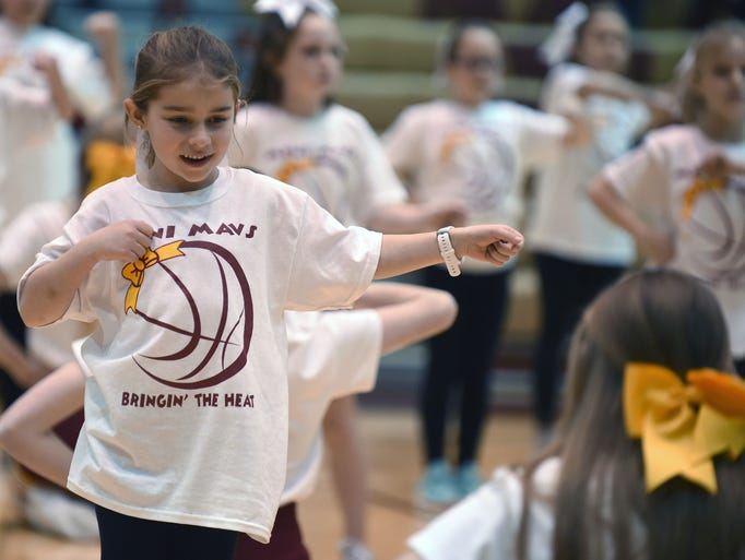 Scenes from an evening of basketball as the McCutcheon