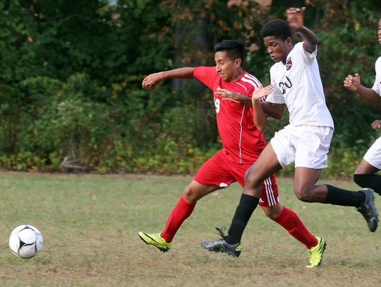 Spring Valley's Makendy Midouin (right) jockeys for position during a soccer game against North Rockland at Spring Valley High School on Sept. 20, 2016.