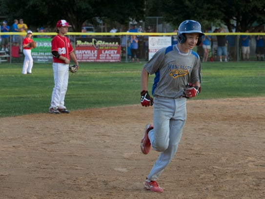 Manchester's Andrew Fischer rounds the bases after