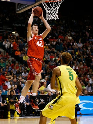 Utah forward Jakob Poeltl (42) dunks in front of Oregon guard Tyler Dorsey (5) during the first half of an NCAA college basketball game in the championship of the Pac-12 men's tournament Saturday, March 12, 2016, in Las Vegas.