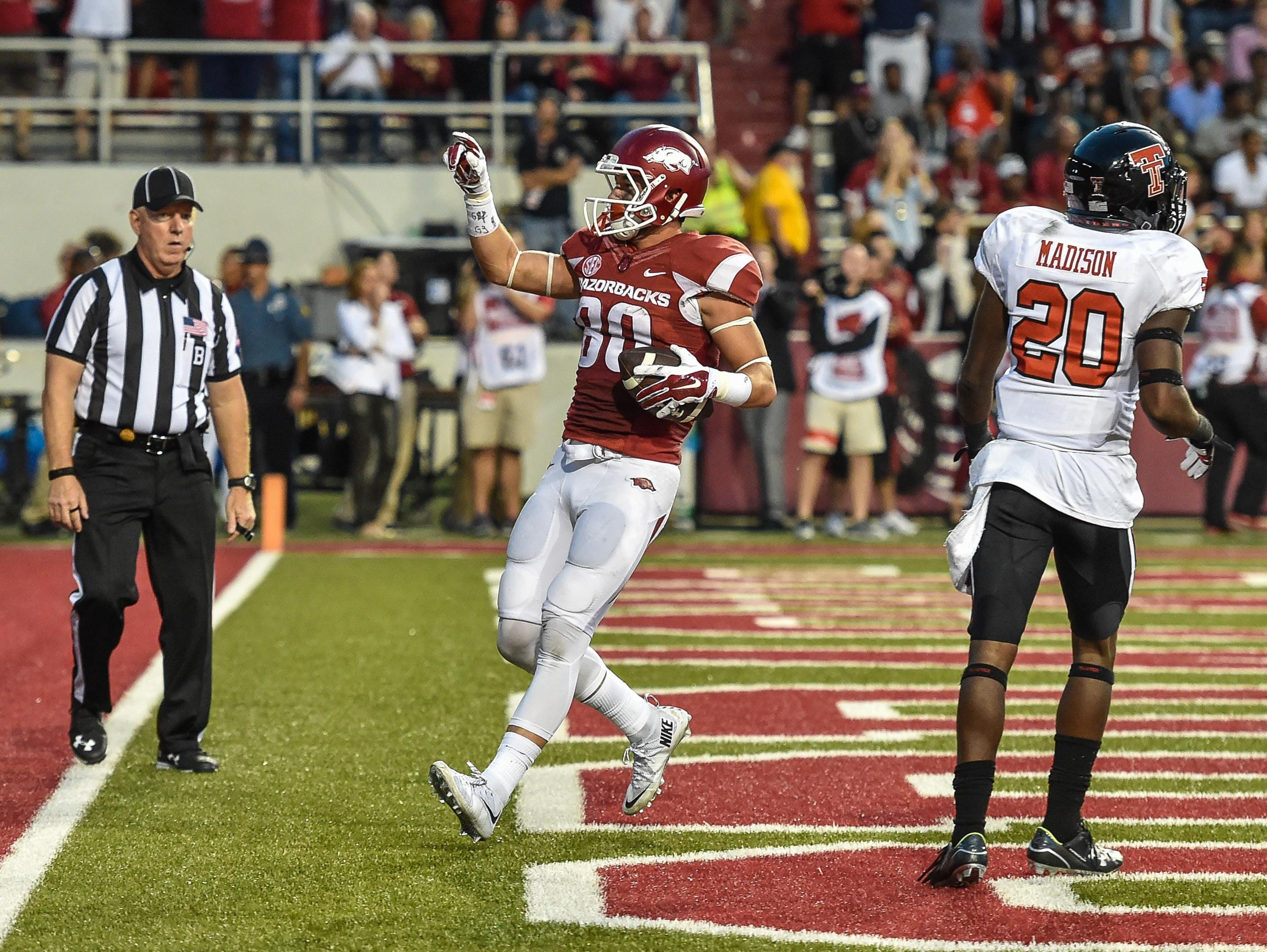 Arkansas wide receiver Drew Morgan (80) celebrates in the end zone after a touchdown during a game between the Razorbacks and the Texas Tech Red Raiders at Reynolds Razorback Stadium in Fayetteville. Texas Tech won 35-24.