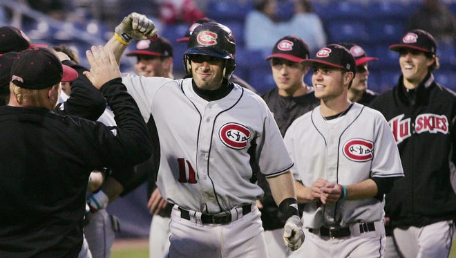 St. Cloud State third baseman Sam Radbil celebrates after hitting a two-run home run during the Division II Central Regional NCAA baseball championship tournament on May 13, 2010, in Farmington, N.M. A Minnesota state university system banned its athletic teams from traveling to tournaments in North Carolina, which passed a law that opponents say can allow discrimination against LGBT people.