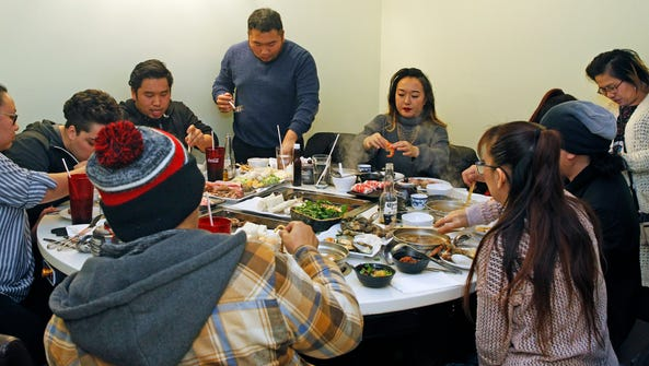 Family and friends enjoy dinner and karaoke on Monday,