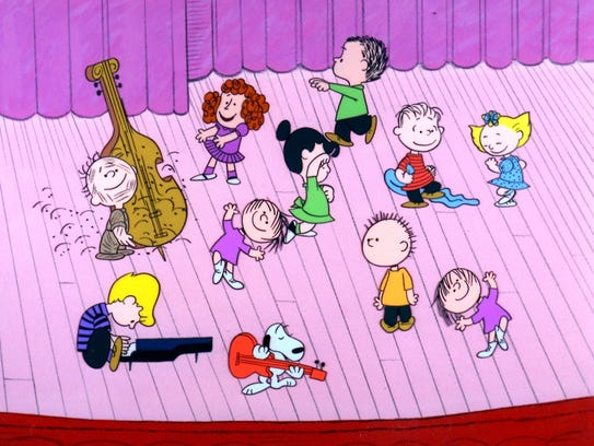 With Schroeder on piano, the Peanuts gang dances to